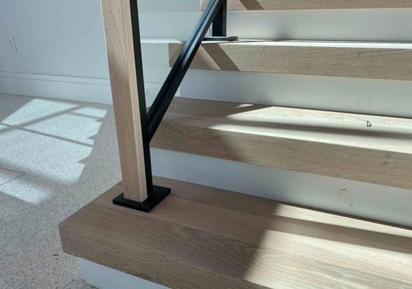 Custom Escutcheon plate on Stair Railing