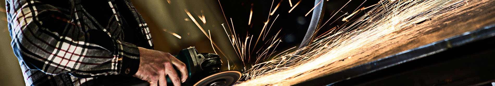 Grinding metal creates fiery sparks.