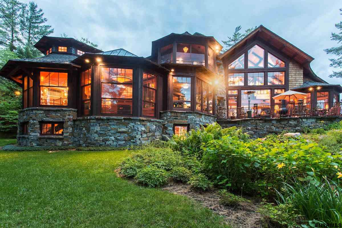 Lake Placid home exterior with iron railing on deck.