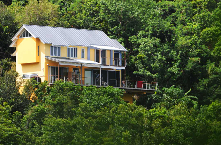 Caribbean home with custom cable railing decks
