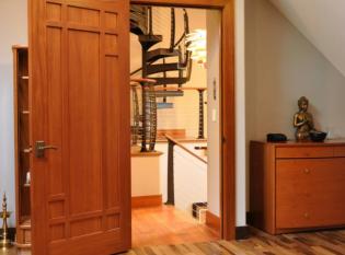 Modern spiral stairs as seen through doorway