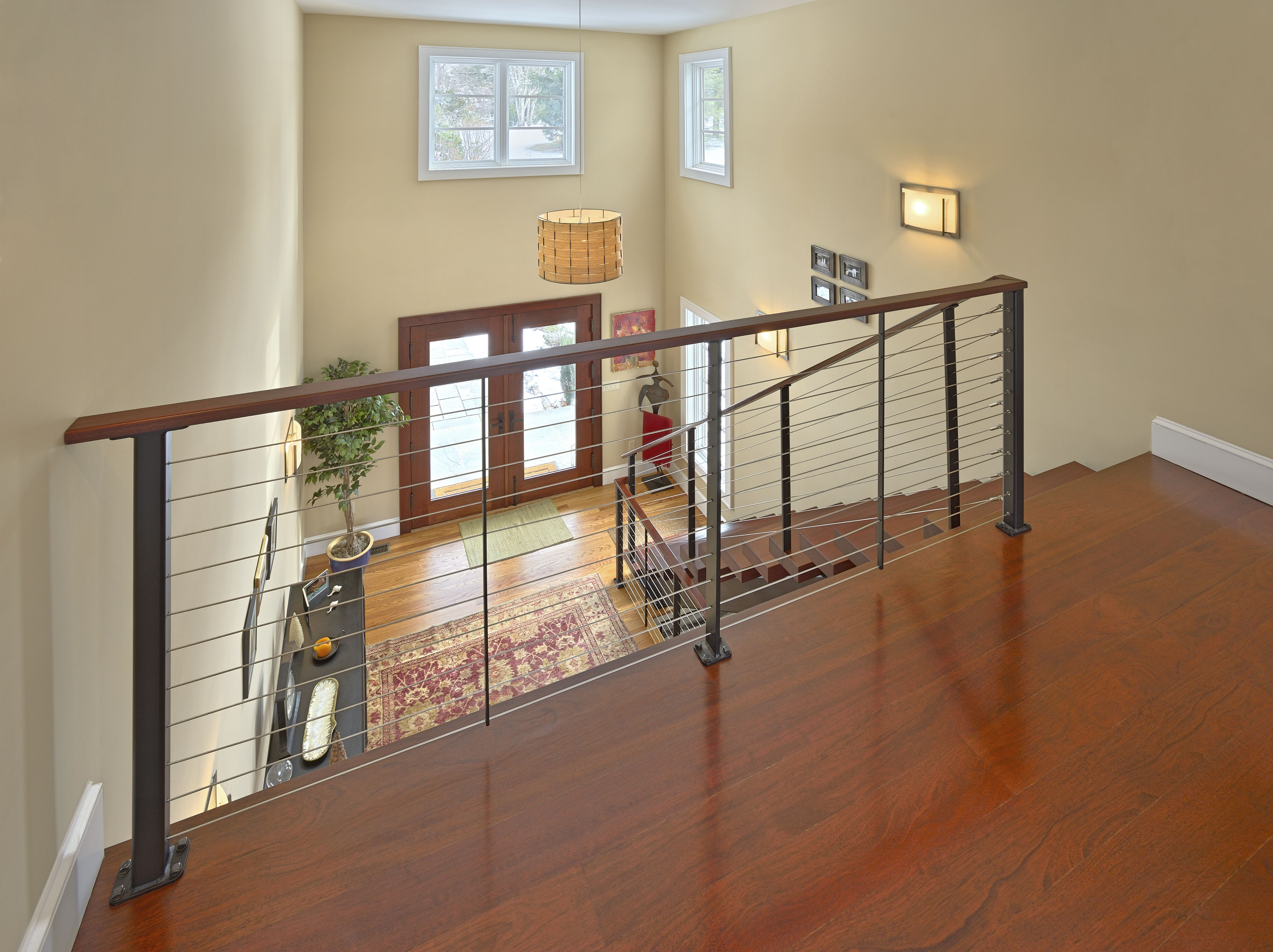 Balcony overlooking entry through cable railing