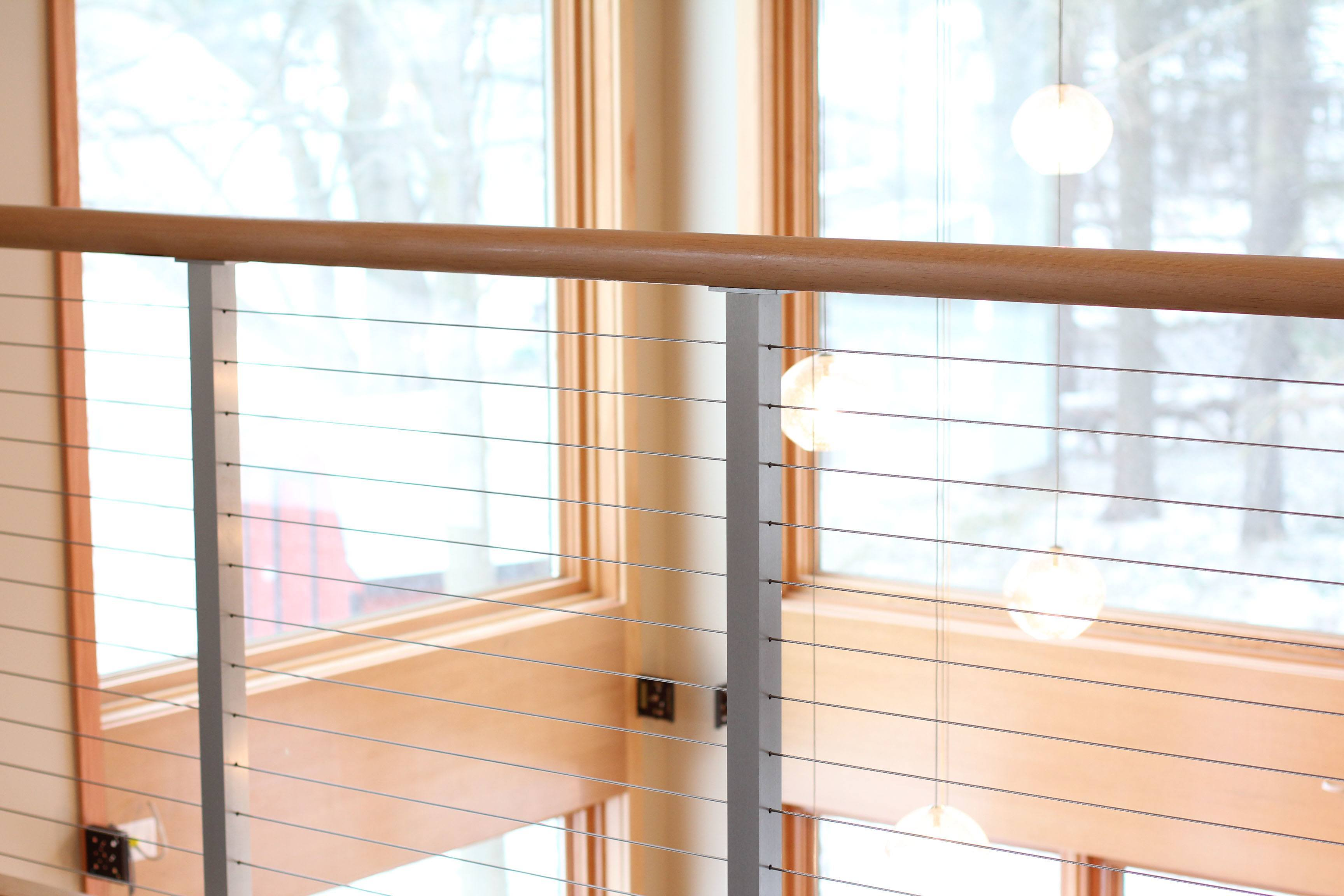 Cable railing allows for an open view out the expansive windows