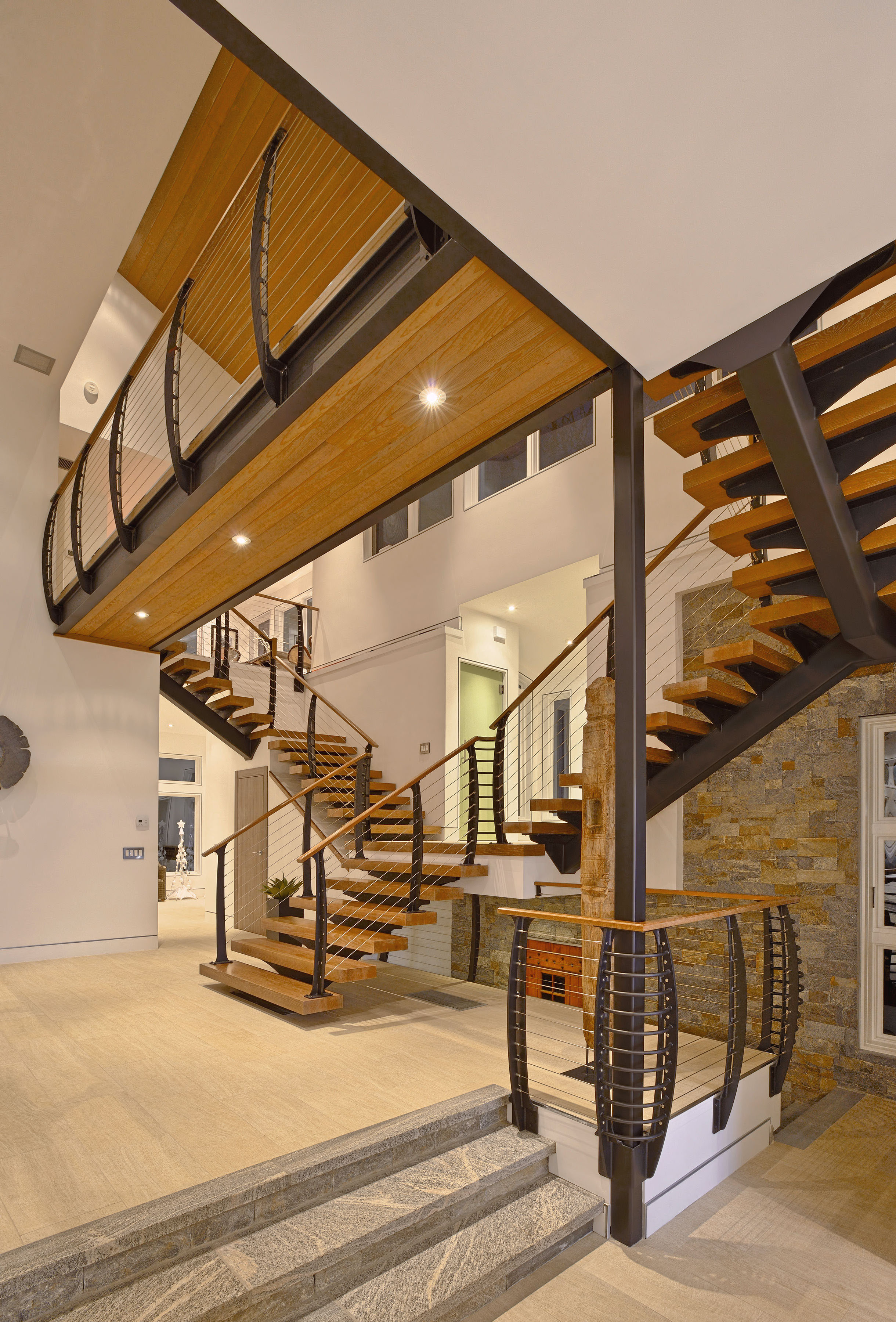 Cable railing catwalk and multi level mono-stringer stair