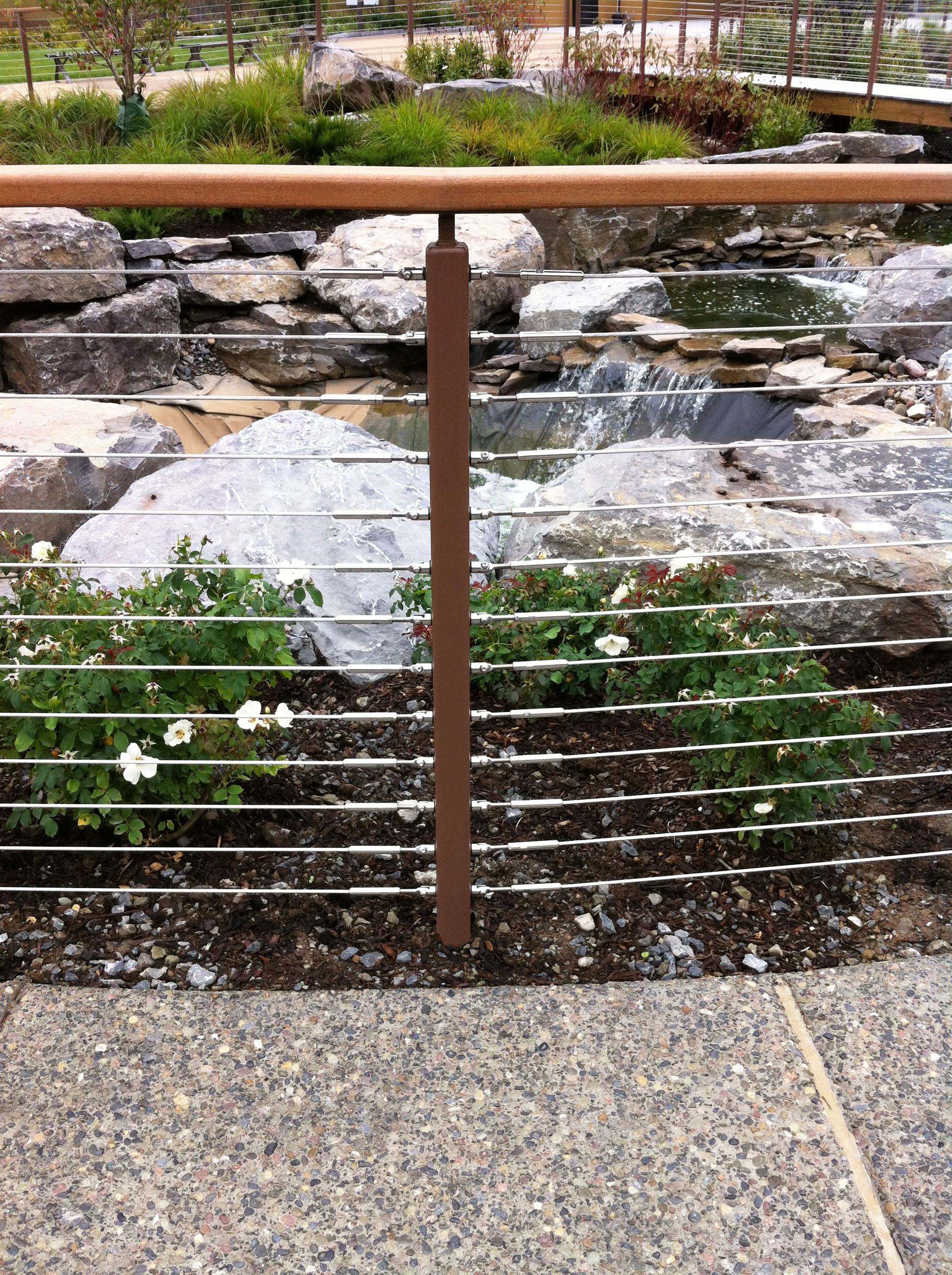 Cable railing with view of the vegetation and rock gardens