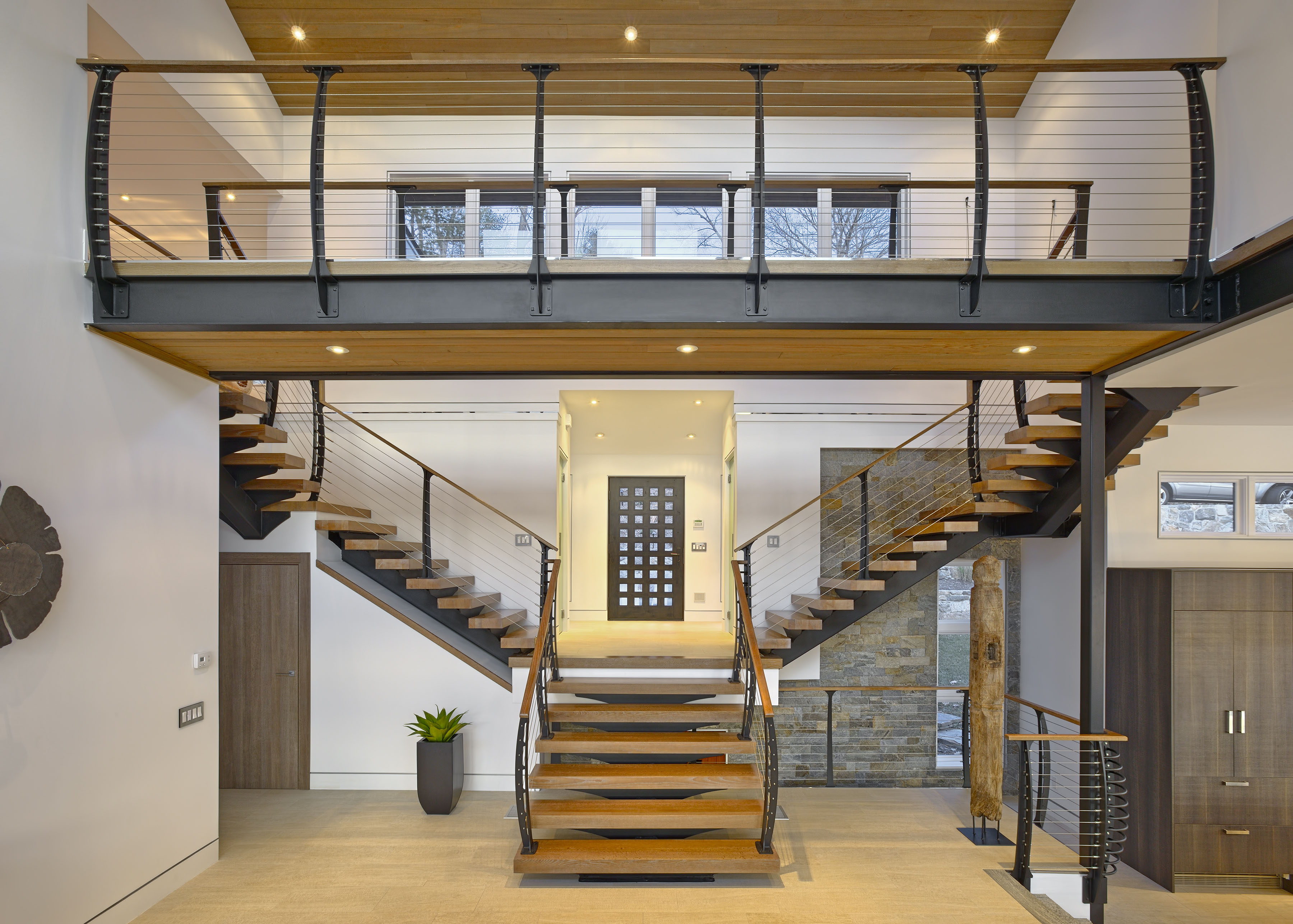 Center entry keuka style cable railing and stairs