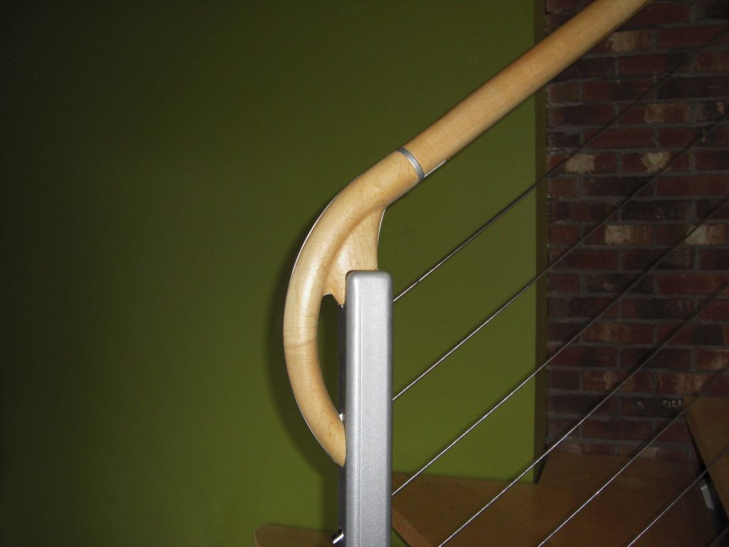 CNC machined newel post and hand rail detail