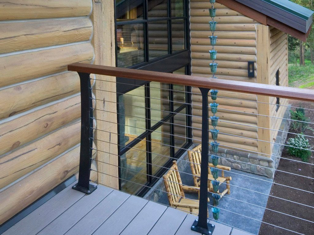 Composite deck with stainless cable railing and wood banister