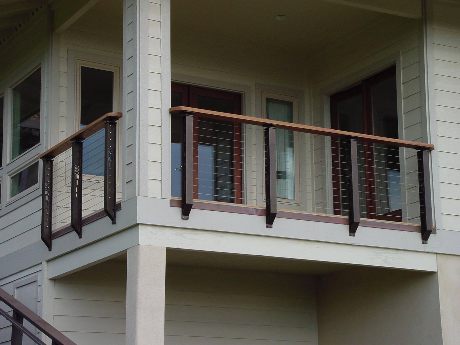 Covered deck cable railing with prairie styling