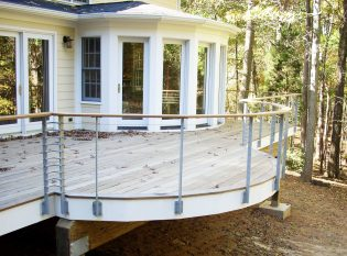 Curved ipe deck with custom posts and 316 stainless cables and fittings