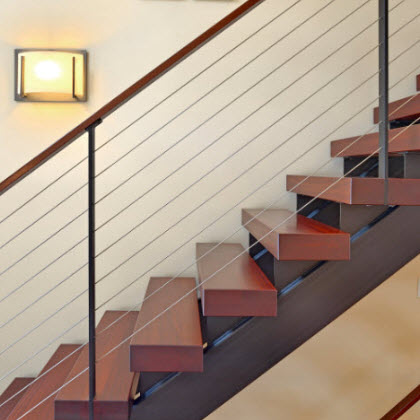 Custom floating staircase and railing with Ithaca style posts.