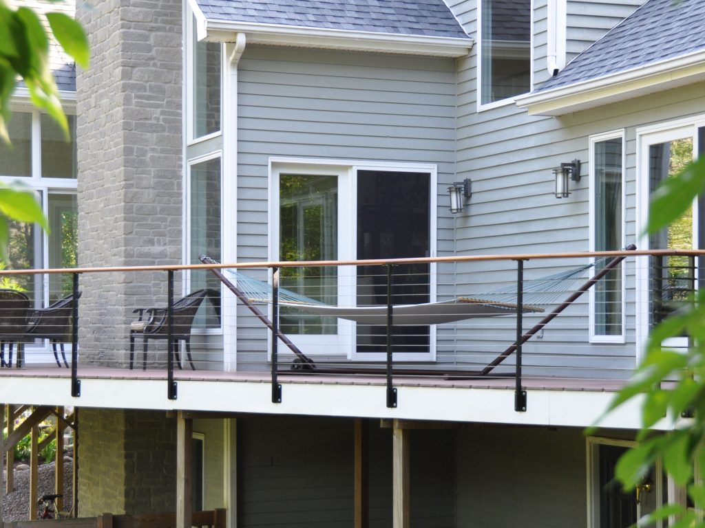 Wood deck with cable railing system and black posts with white trim