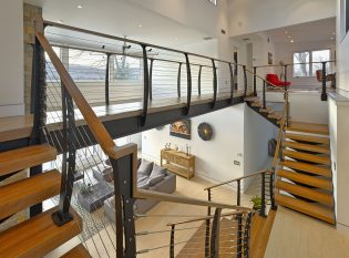 Double interior staircase with stainless cable railing system