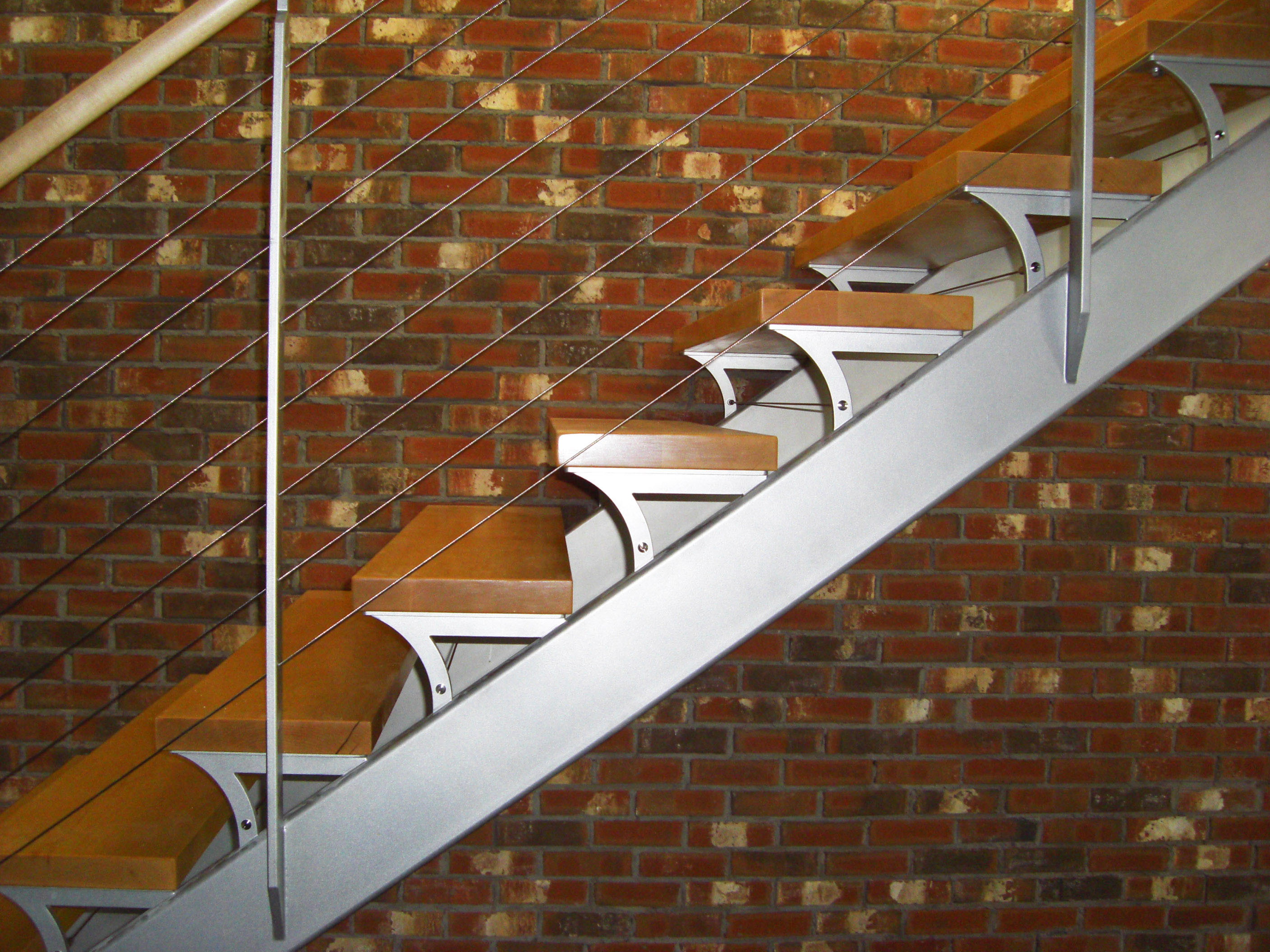 Dual stringer steel stair with dog leg and custom tread supports