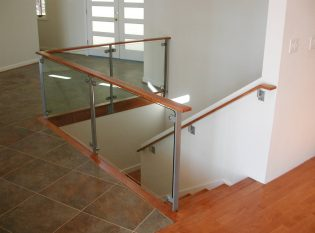 Glass rail around interior stairwell