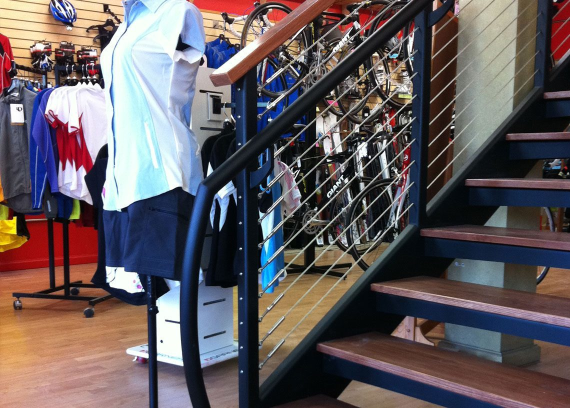 Handrail Design On This Metal Staircase To Work With Wood Floors And Retail Space