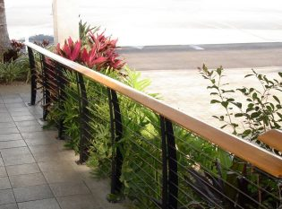 Curved cable railing posts