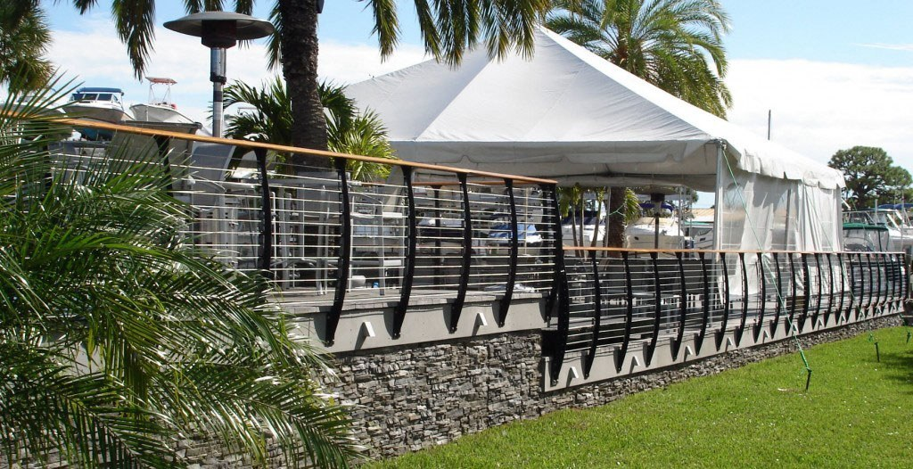Marina deck railing with party tent.