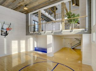 Indoor basketball court with open loft for viewing the game