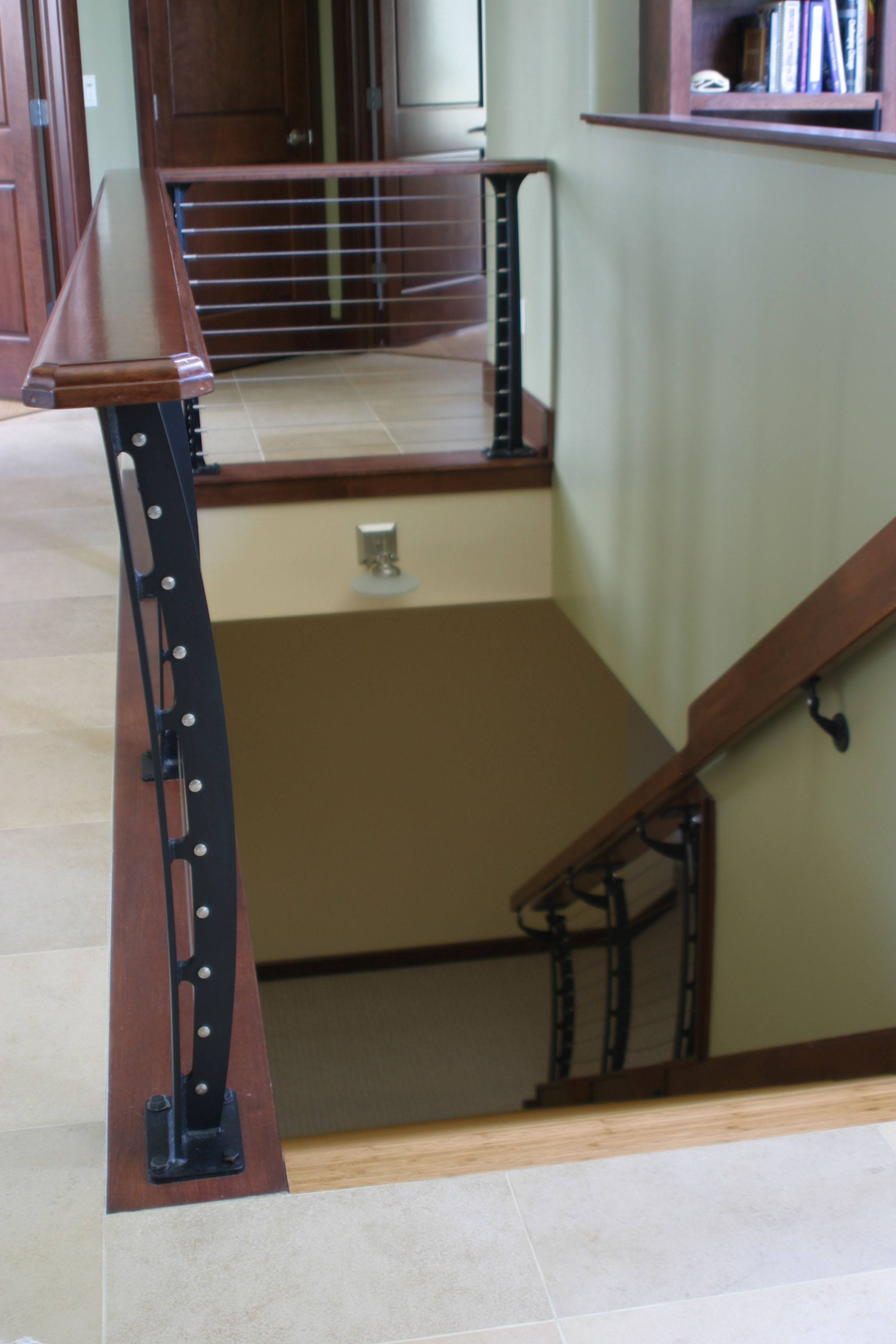 Cable guard rail around stair opening