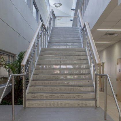 cable railing and ADA compliant graspable handrail on interior staircase at the Jacksonville University.