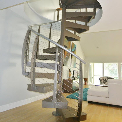 Custom made spiral staircase leading to upper level balcony