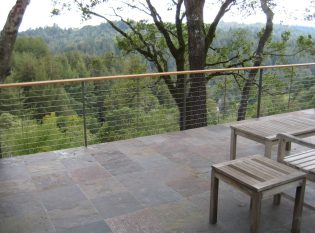 Keuka Studios Ithaca style railing complements the slate deck and rolling hillside