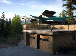 Large deck over garage with sail shades (2)