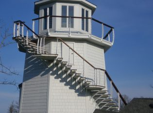 Residential light house wrap around deck