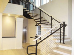 Light Wood And Dark Steel Railing Creates A Striking Contrast