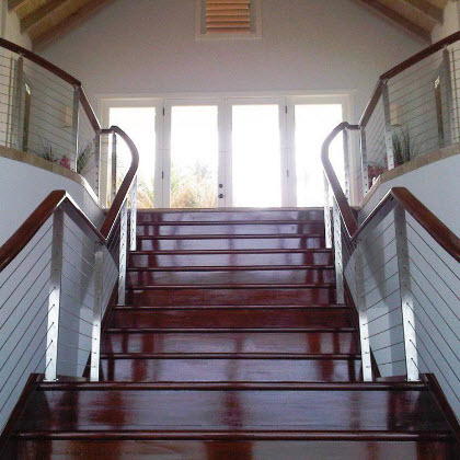Stainless steel stair railing with mahogany treads