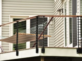 Modern cable railing system on deck