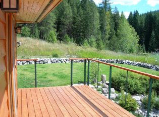 Mountain vista with rock landscaping seen through cable railing