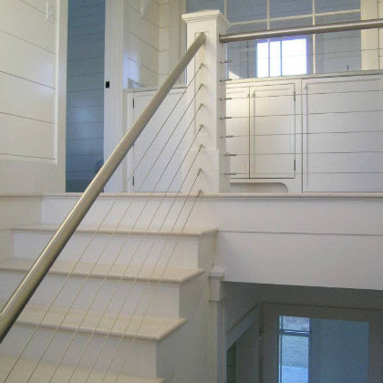 Cable railing and stainless steel hand rail.