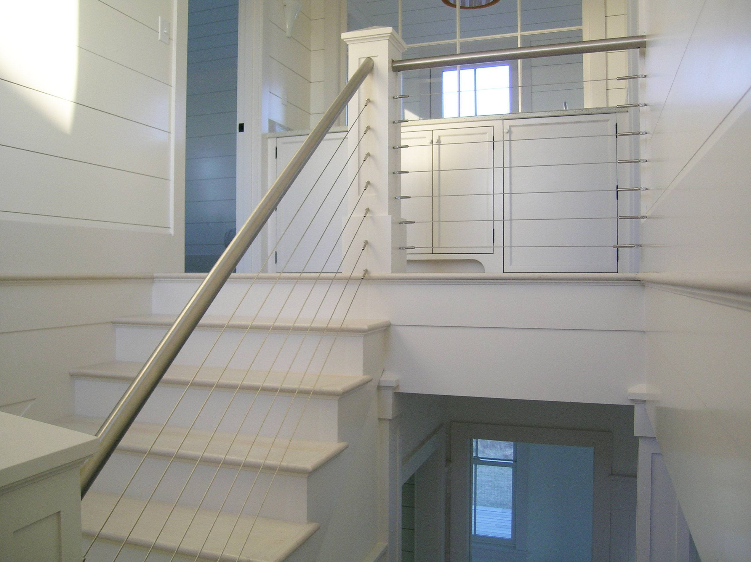 Nantucket white bead board and stainless steel railings