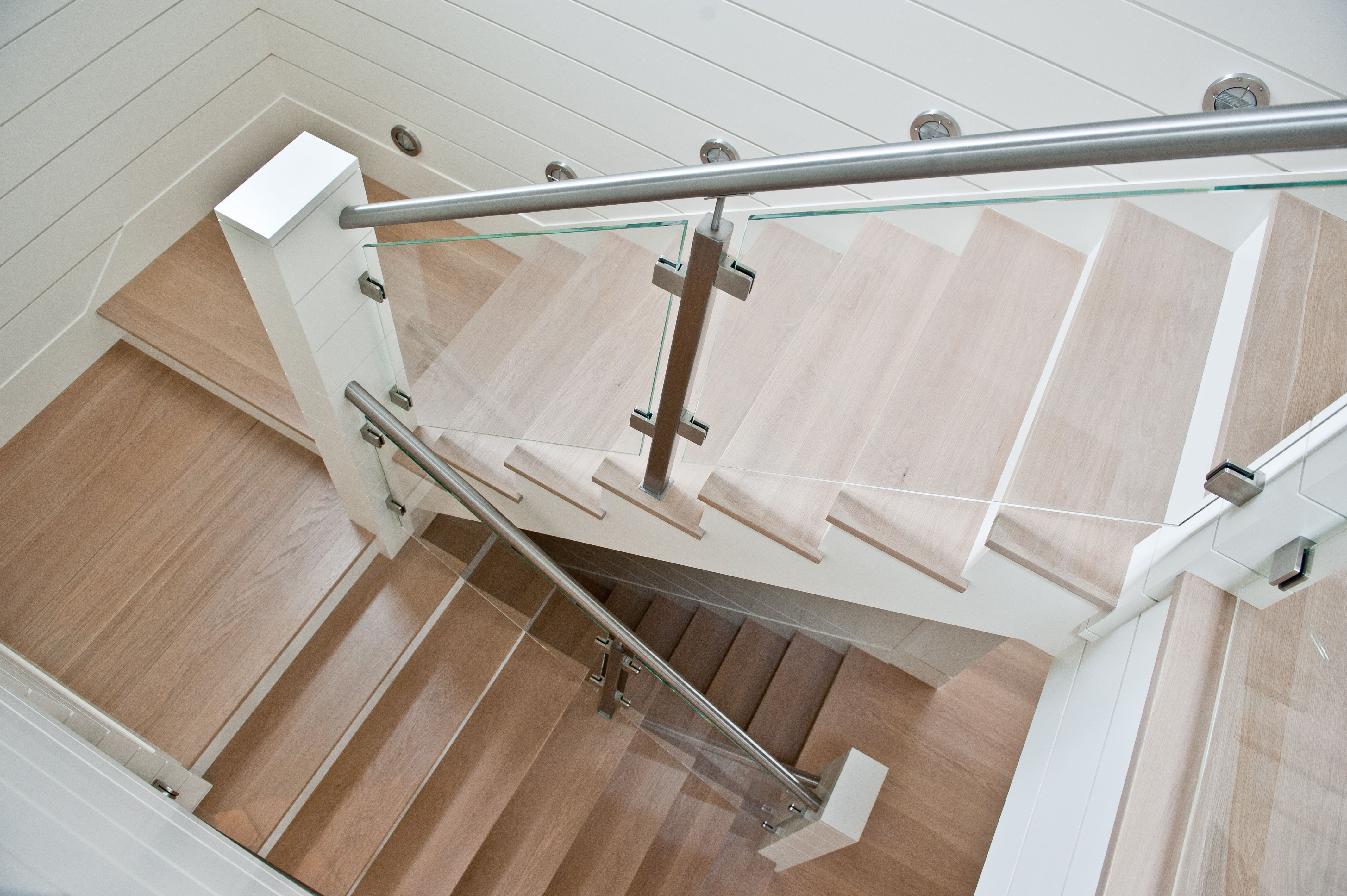 Glass railing with stainless steel hand rail