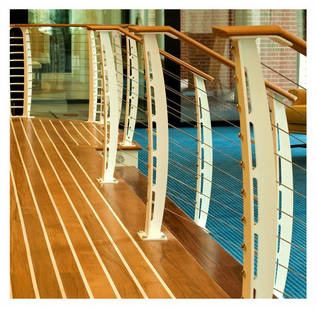 close up of nautical cable railing with teak floors