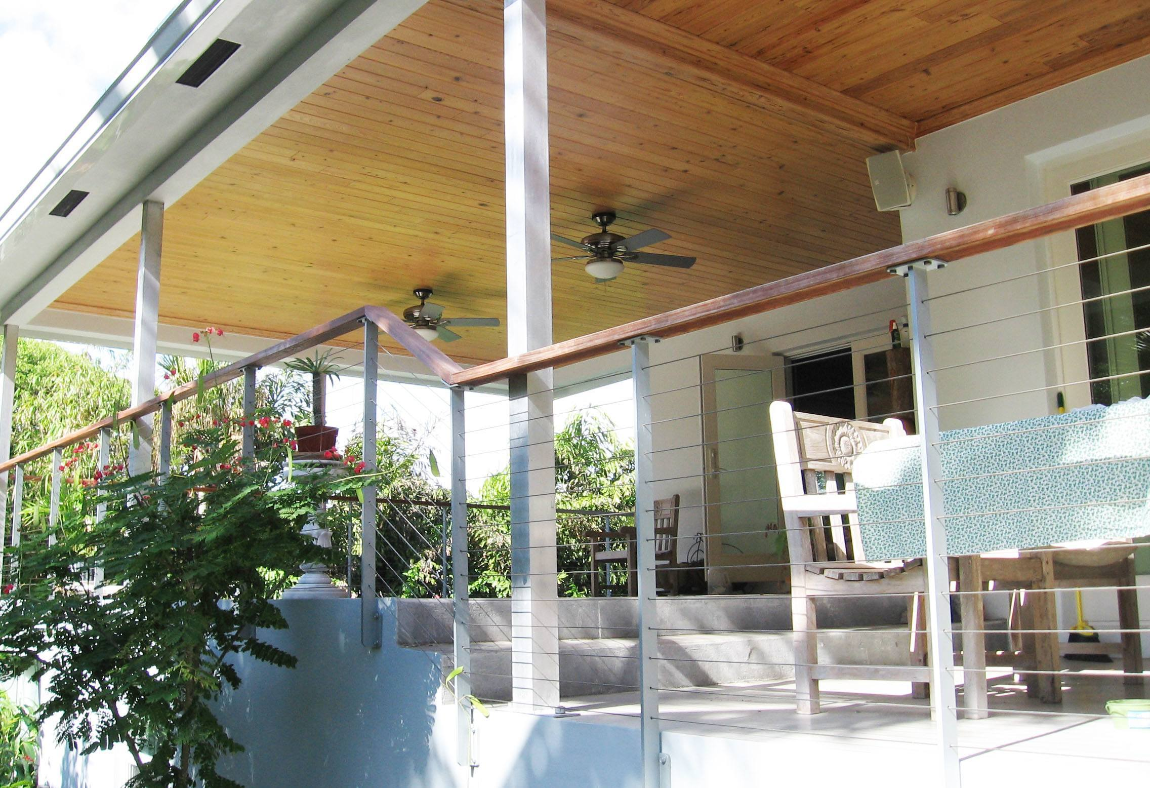 Outdoor deck with ceiling fans
