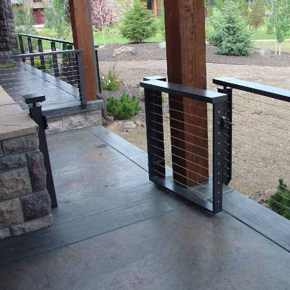 Custom cable railing designs include the Prairie Cable railing and gate with a Pine Tree cut out in the post