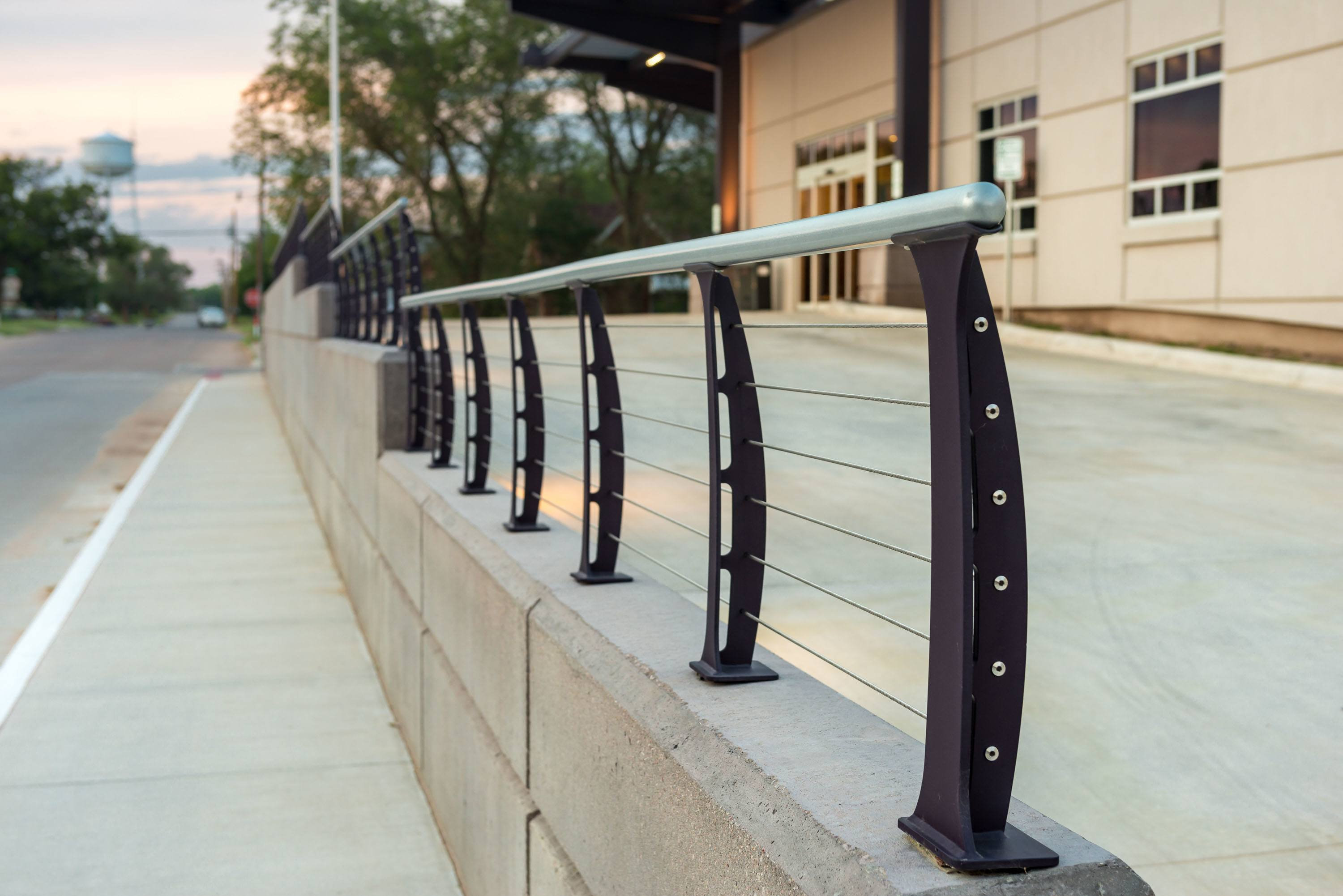 Railing mounted on retaining wall