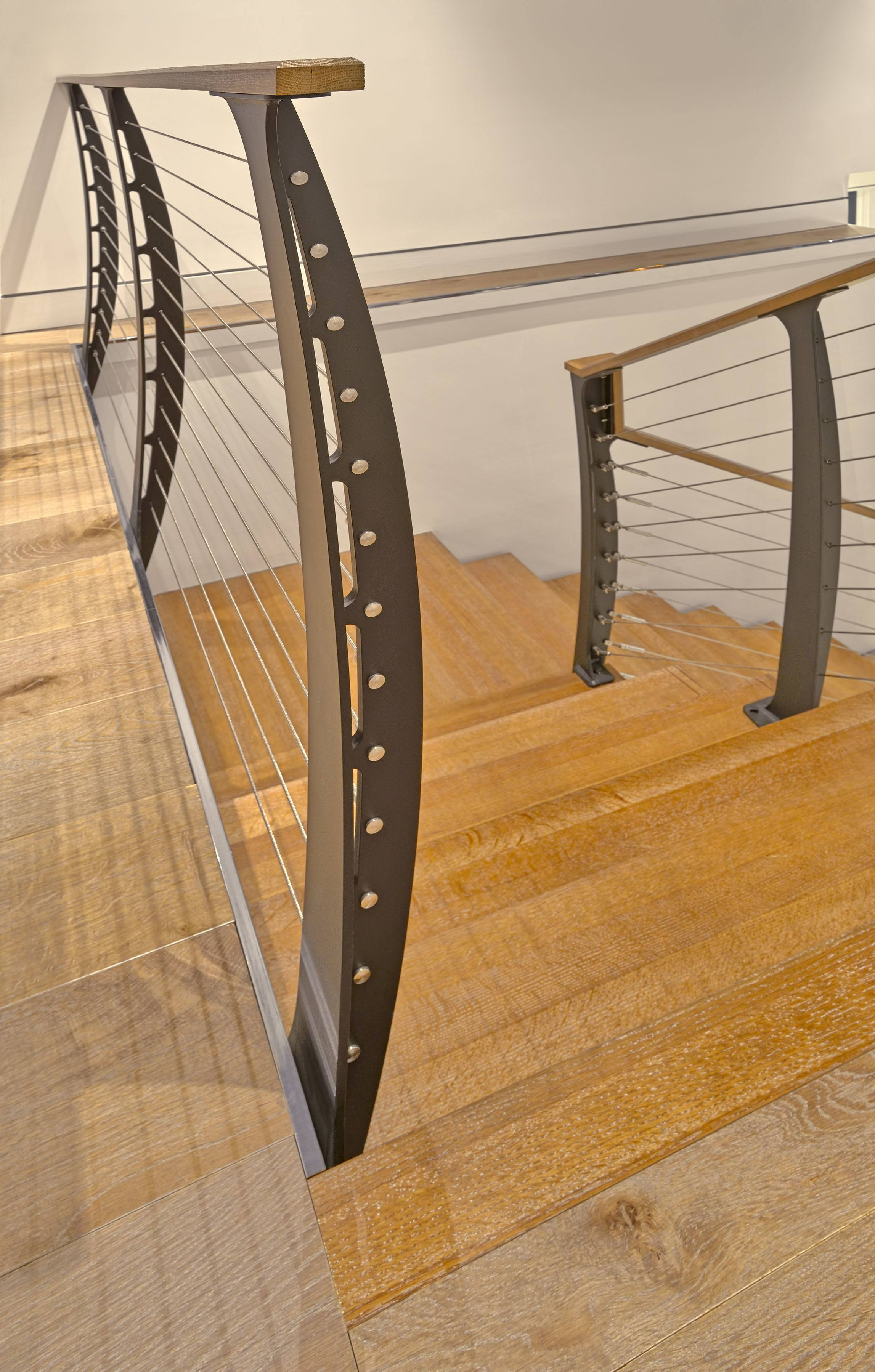 Reclaimed oak stairs with steel railing system