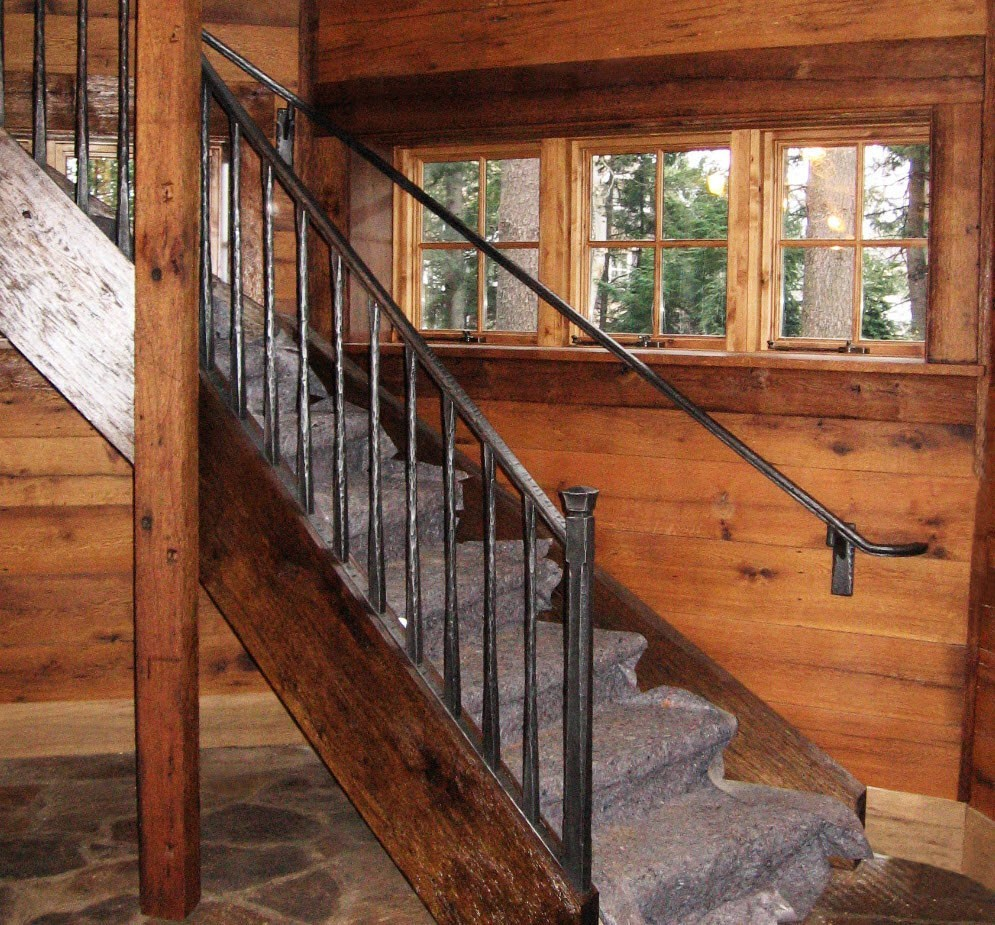 Rustic iron railing with wax finish applied by hand.
