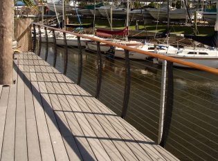 Sailboats and harbor cable railing views