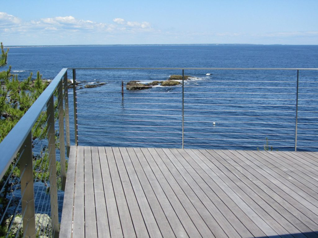 Stainless wire rope railing practically vanishes preserving the ocean view