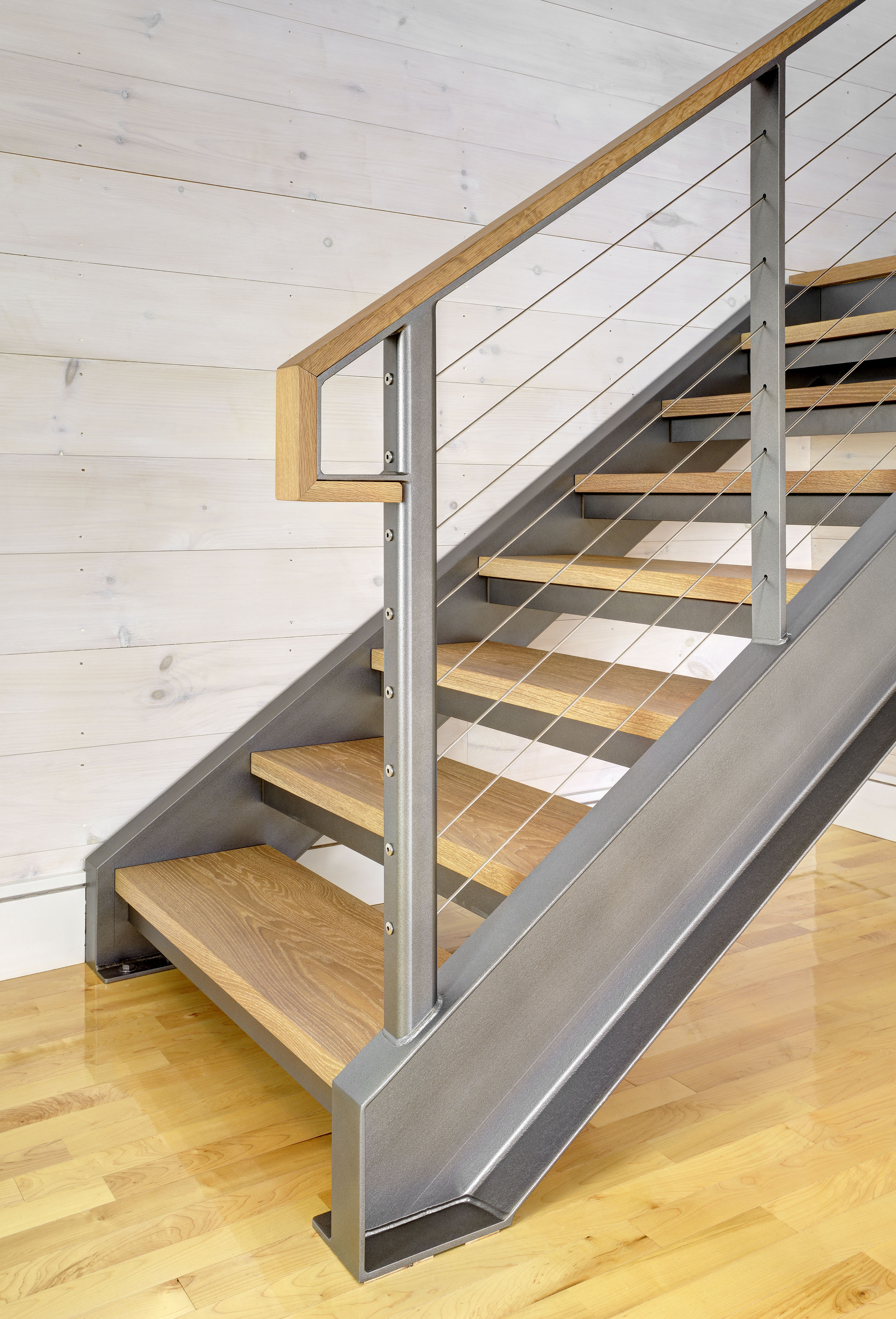 Steel channel stringers staircase with cable railing