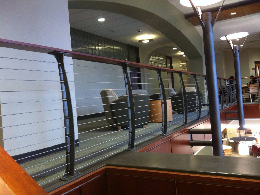 The library loft at albany college over looking the main lobby with curved cable rail system
