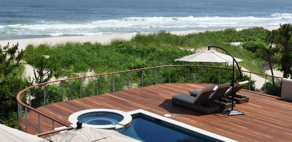 Pool deck railing overlooking the ocean on the Jersey shore.