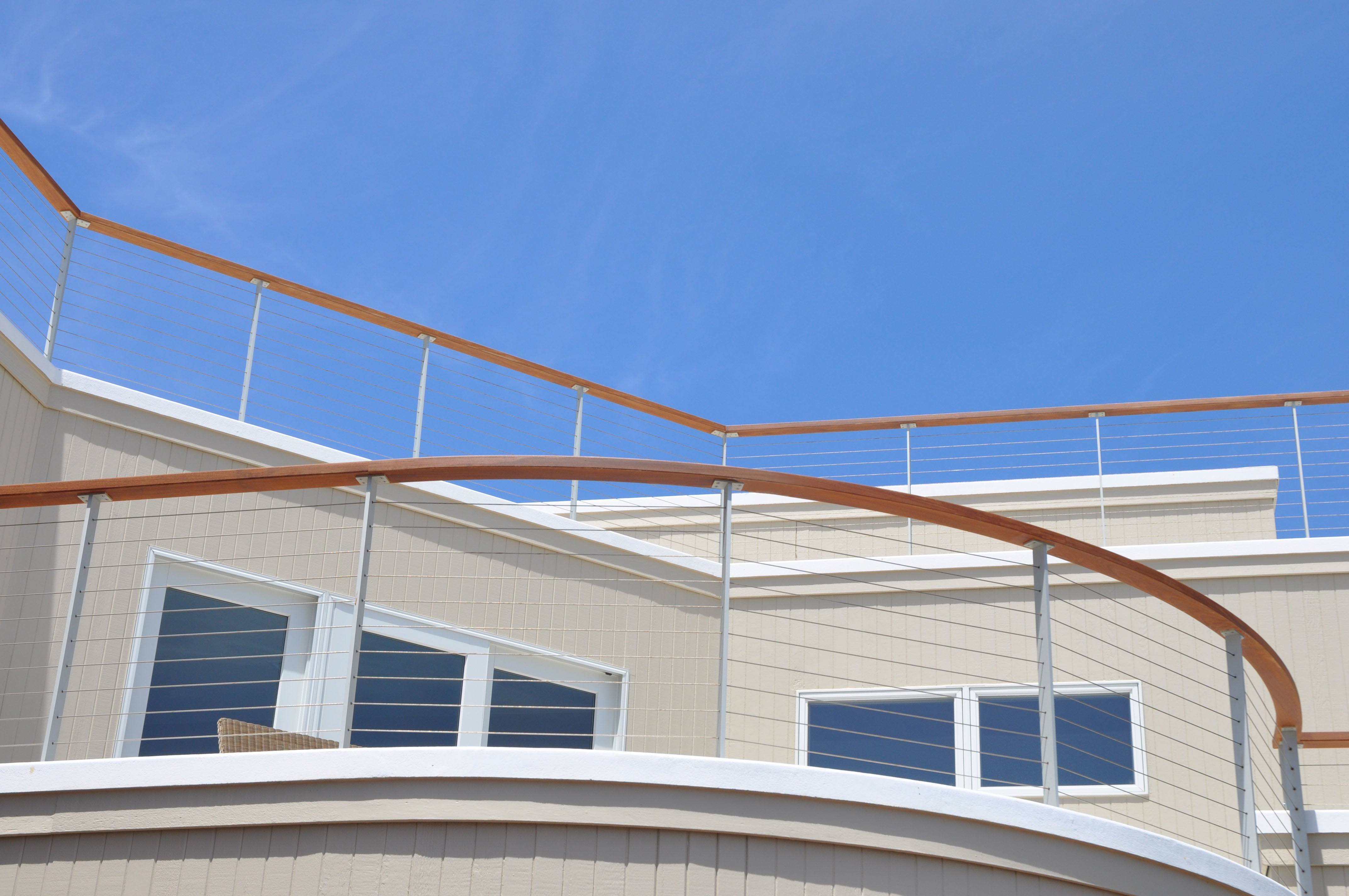 This Ithaca style Anodized Aluminum cable railing complements this Jersey shore home
