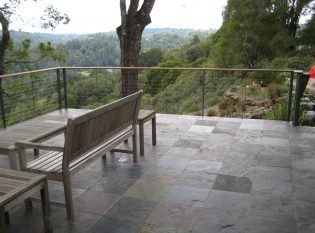 Wood top rail, slate deck and metal railing create an aesthetically pleasing escape