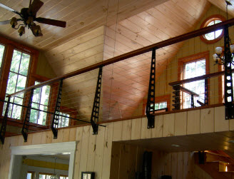 Knotty pine loft with industrial styling and cable railing system